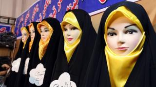 Headscarves are displayed on mannequins at an Islamic fashion exhibit in central Tehran on 18 December 2014