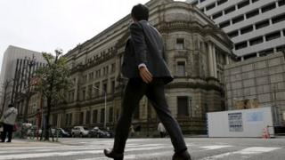 BOJ building and man walking past it