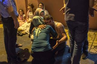 Relatives grieve at hospital August 20, 2016 in Gaziantep