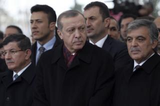 Turkey's President Recep Tayyip Erdogan, centre, former president Abdullah Gul, right, and former prime minister Ahmet Davutoglu, left, attend funeral prayers for Korkut Ozal, 87, a former Turkish government minister and brother of Turkeys late president Turgut Ozal, at Fatih Mosque in Istanbul, on 4 November 2016.