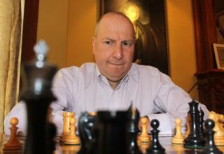 David looks at the chess board