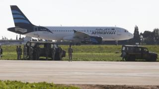 Afriqiyah Airways plane surrounded by troops at Malta Airport (23 December)