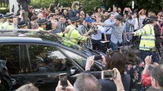Crowds gather around Boris Johnson's car as he leaves his home in Islingto