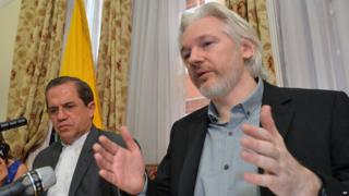 File photo from 2014 shows Ecuador's Foreign Minister Ricardo Patino, left, and WikiLeaks founder Julian Assange inside the Ecuadorian Embassy in London