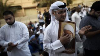 Bahraini demonstrators attend protest against revocation of citizenship of Shia cleric Sheikh Isa Qassim, on June 20, 2016 near Qassim's house in village of Diraz, west of Manama