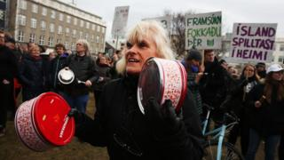 People protest in front of Parliament building in Reykjavik