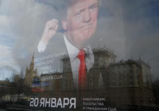 """An image of U.S. President-elect Donald Trump is seen on the advertising board of the store """"Army of Russia"""", located opposite the U.S. embassy, in Moscow"""