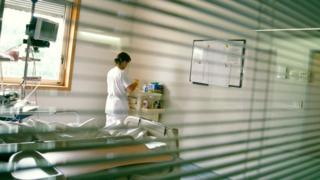 Hospital room. Nurse at a workstation in a patient's room in a hospital.