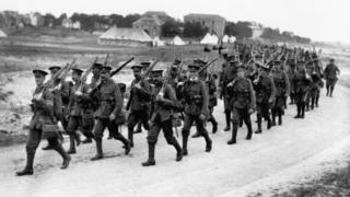 British infantrymen on the march towards the front lines in the River Somme valley.