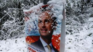 A banner of Austrian presidential candidate Norbert Hofer is covered with snow in Gnadenwald, Austria, April 27, 2016.