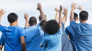 Volunteers raising their hands