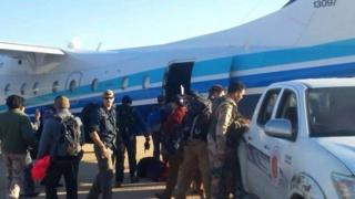 US forces get back on a plane