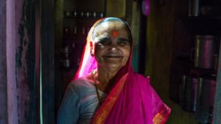 Ramabhai Ganpat smiling in a pink sari