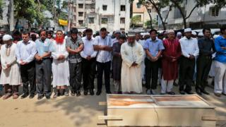 Bangladeshi Muslims attend the funeral of Xulhaz Mannan who was stabbed to death by unidentified assailants, in Dhaka, Bangladesh, Tuesday, April 26, 2016