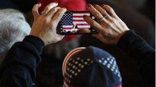 American filming Trump on smartphone