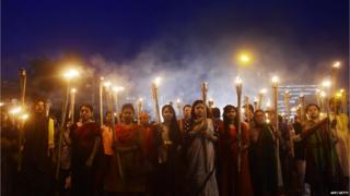 Bangladeshi secular activists taking part in a torch-lit protest against the killing of Avijit Roy, a US blogger of Bangladeshi origin