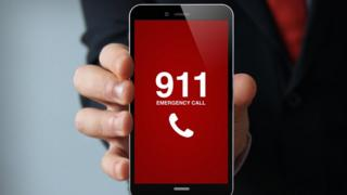 mobile phone with 911 displayed