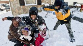 Five children play in the snow