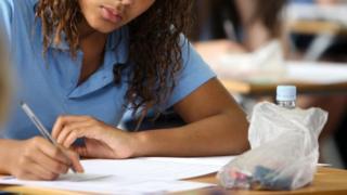 Girl taking school exam