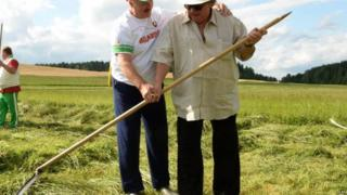 President Alexander Lukashenko and French actor Gerard Depardieu (right) hold a hand scythe. Photo: 22 July 2015