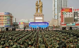 This photo taken on 27 February 2017 shows ranks of Chinese military police attending an anti-terrorist oath-taking rally in Hetian, northwest China's Xinjiang region.