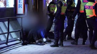 Police detain suspects in Stockholm after masked men clashes with officers