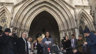 Lead claimant in the Article 50 case, Gina Miller (C), gives a statement outside of the High Court after a decision ruling in her landmark lawsuit