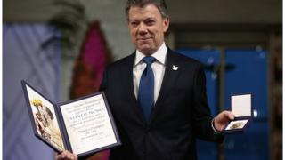 Nobel Peace Prize Laureate Colombian President Juan Manuel Santos poses with the medal and diploma during the Peace Prize awarding ceremony at the City Hall in Oslo on Saturday Dec. 10, 2016