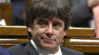 Carles Puigdemont wears a smirk during a session of the Catalan parliament in this file photo