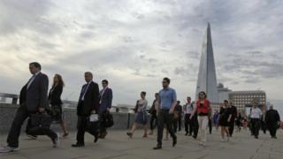 Workers walking across London Bridge