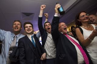 People react to a regional EU referendum result at the Leave.EU campaign's referendum party at Millbank Tower