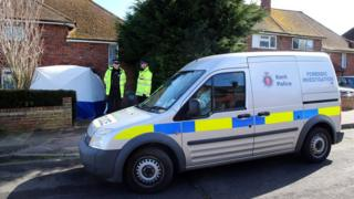Police officers outside a property in Dickens Avenue in Canterbury