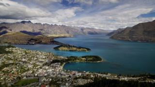 Queenstown is seen on the shores of Lake Wakatipu with the Remarkables mountain range in the background.
