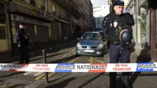 French police stand behind a cordon set up near where the attack happened