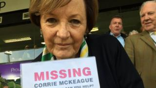 Delia Smith holding a police poster asking for information about missing 23-year-old Corrie Mckeague.