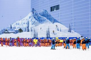 Skiers queuing to get on the slope