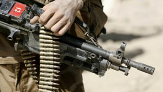 British Soldier on patrol in the green zone in the Helmand province, Southern Afghanistan
