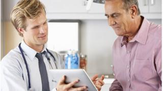 doctor with patient discussing results