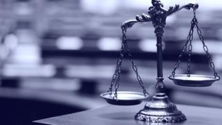 Picture of a decorative scales of justice in the courtroom