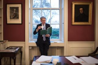 Chancellor of the Exchequer Philip Hammond reading through his Autumn Statement in his office in 11 Downing Street