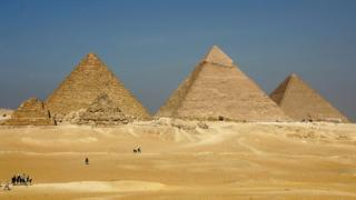 The three large pyramids of Menkaure (L), Khafre (C) and Khufu are among Egypt's biggest tourist attraction