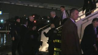 """Republican presidential candidate Indiana Gov. Mike Pence walks down the steps of his campaign plane at New York""""s LaGuardia Airport"""