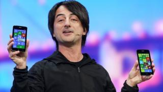 Joe Belfiore holding Windows phones