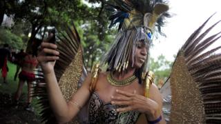 A costumed participant in golden feathered wings and headdress takes a selfie during the annual Sydney Gay and Lesbian Mardi Gras festival in Sydney, Australia March 4, 2017.