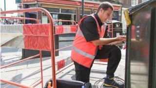 Man installing superfast Virgin Media broadband