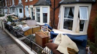 Damaged household goods on the street after the Carlisle floods