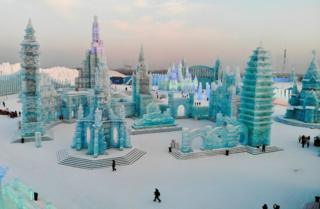 Visitors walk around ice sculptures at the annual Harbin Ice and Snow Festival