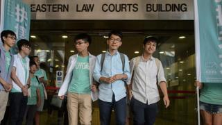 Pro-democracy political activists and members of the Demosisto party (centre back L to R) Nathan Law, Joshua Wong and Alex Chow