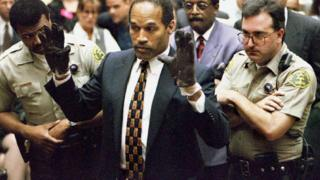OJ Simpson shows the jury leather gloves in 1995