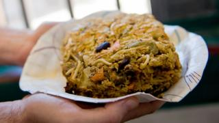 An inmate holds a serving of Nutraloaf in South Burlington, Vermont, 2008